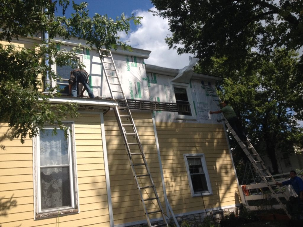 replacing vinyl siding on home